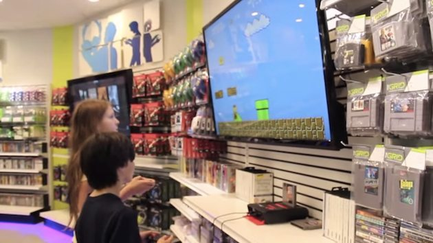 Kids playing videogames in The GRID featured in Engadget.com